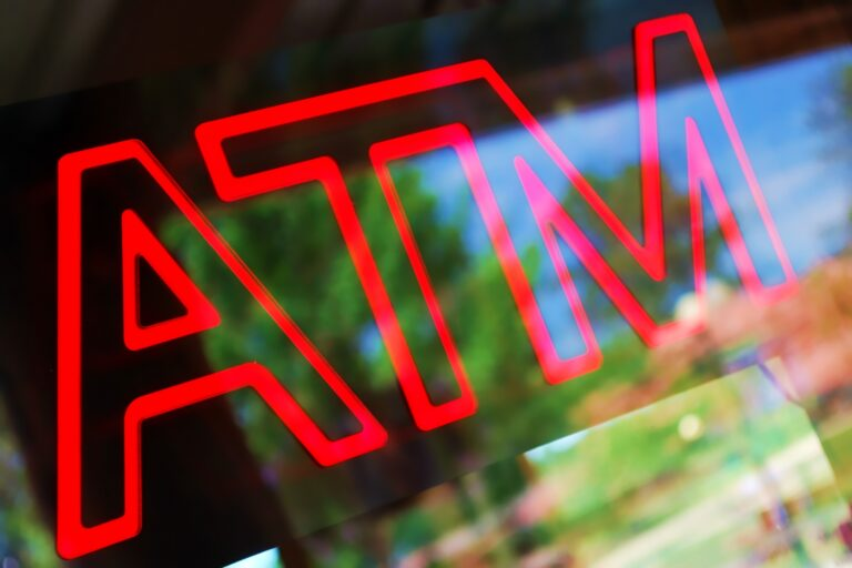 ATM neon sign in store window
